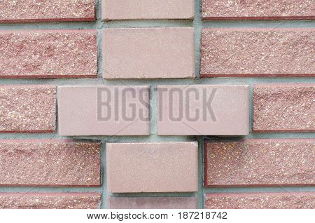 Masonry brickwork with a decorative element in the form of a cross.