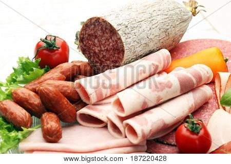 Food Tray With Delicious Salami, Pieces Of Sliced Ham, Sausage, Tomatoes, Salad And Vegetable - Meat