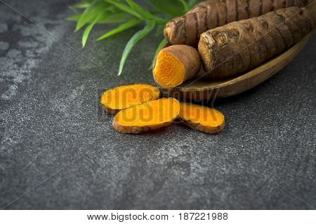 turmeric slices close up on gray background