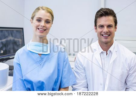 Portrait of happy nurse and dentist in clinic