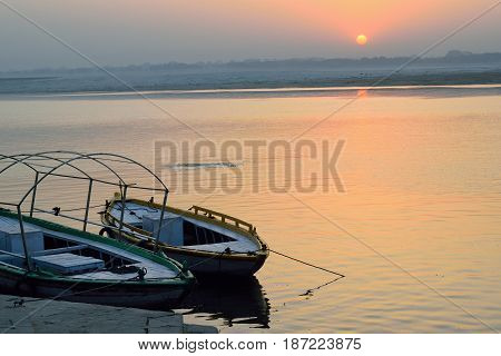 Wooden boats at Ganges river banks in Varanasi, India