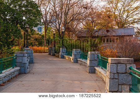 The stone bridge on the Lake Clara Meer in the Piedmont Park in autumn day Atlanta USA
