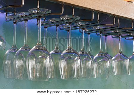 Wine Glasses Hanging On A Stemware Rack