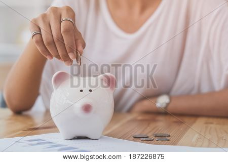 young beautiful woman saving money, selective focus, vintage