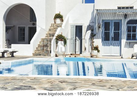 Luxury swimming pool in resort romantic holidays Santorini cyclades Greece