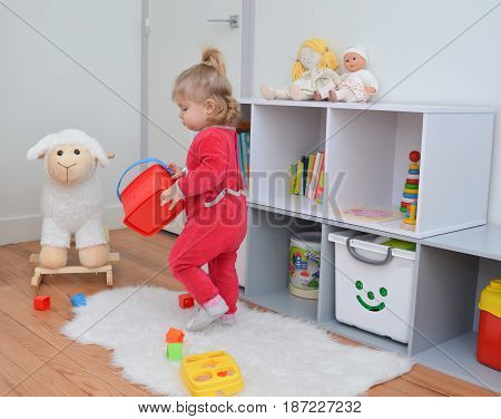 Girl playing with toys in the children's room