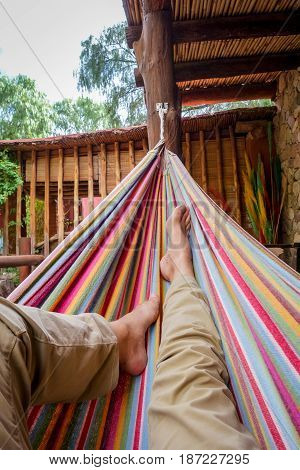 Man relaxing in a colored hammock. subjective view
