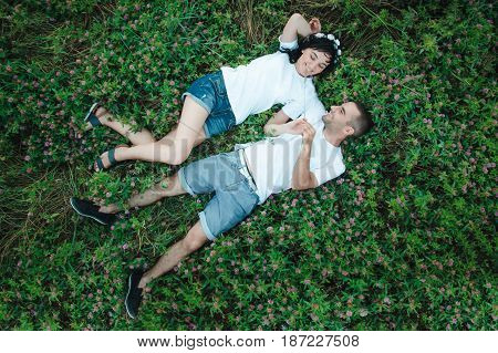 the guy with the girl lying on the grass. photo from the top