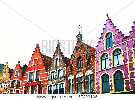 Famous colorful brick houses on the Grote Markt square in the medieval old town of Bruges Belgium Europe. Belgian traditional architecture.
