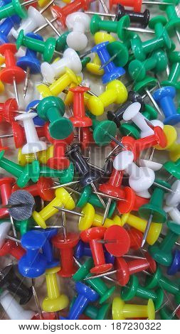 Set of push pins in different colors. Thumbtacks. Top view. pin in box