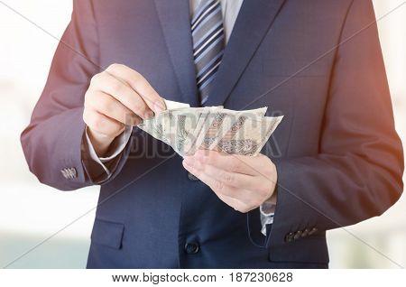 Range Of Polish Banknotes In Businessman Hand