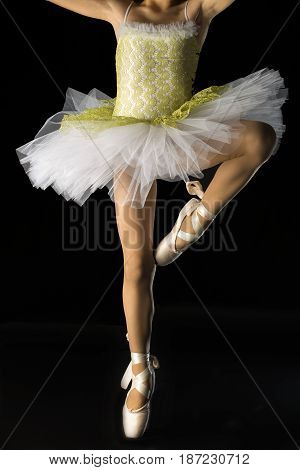 Detail of pose of Ballet dancer with green dress