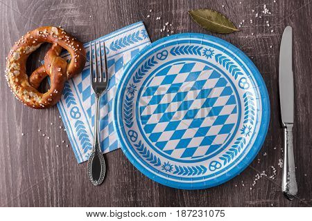 Empty Bavarian plate with pretzel. Top view