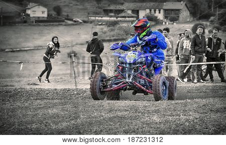 GOZON SPAIN - MAY 13: Unidentified racer rides a quad motorbike in the