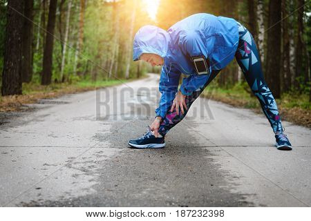 Woman Stretching Leg As Warm-up Before Run With Sport Activity.