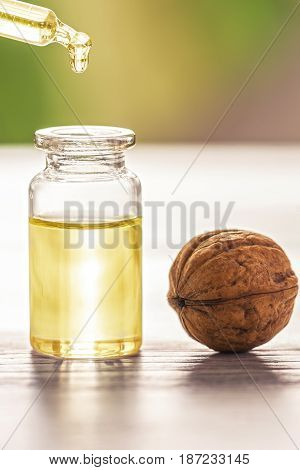 The walnut oil in a small bottle and pipette with drop