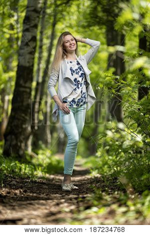 woman outdoor portrait, young woman walking in summer park
