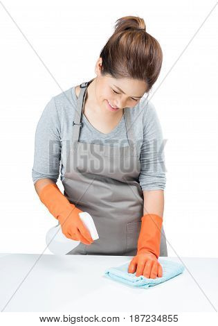 Asian Housewife Sweeping On Table