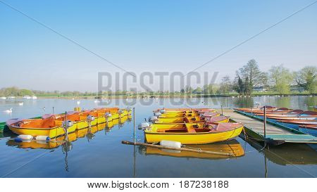 boat park on beautiful lake river in park nice weather nature and blue sky / boat at lake