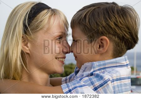 Smiling Boy And  Happy Mom In The Summer Holiday
