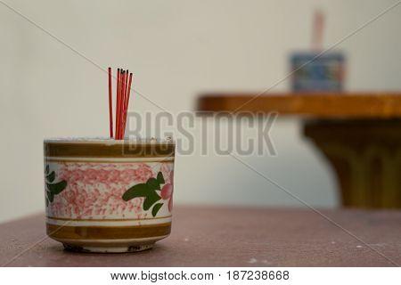 burned incenses in the incense burner on table