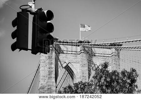 American flag on Brooklyn bridge seen from Brooklyns streets