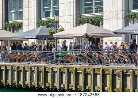 Dockside Bar In Canary Wharf Packed With People Drinking