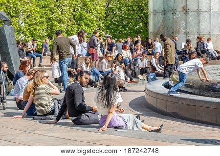Cabot Square In Canary Wharf Packed With People Sitting And Chatting