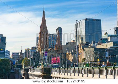Princes Bridge And St. Pauls Cathedral Against Melbourne Cbd Buildings