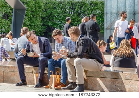 Three Businessmen On Their Lunch Break In Cabot Square, Canary Wharf