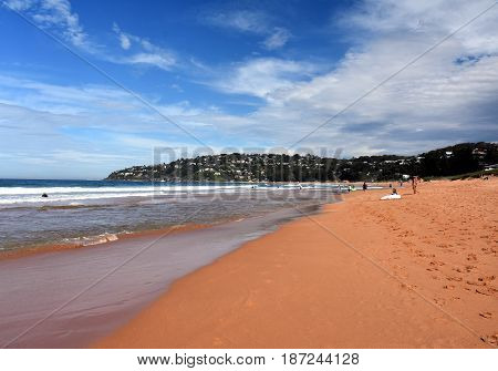 Sydney Australia - Apr 25 2017. People relaxing at the beach on ANZAC Day. Palm Beach one of Sydney's iconic northern beaches.