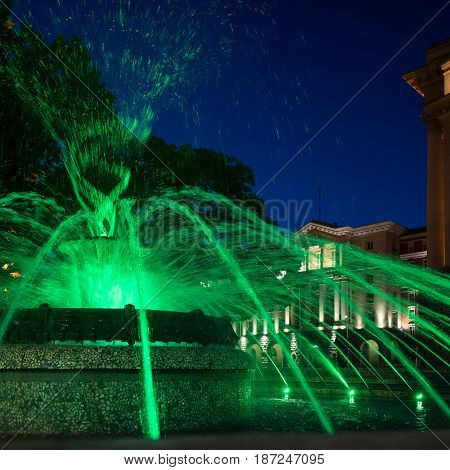 Eruption of green waters on the fountain close to the Bulgarian Parliament, Sofia