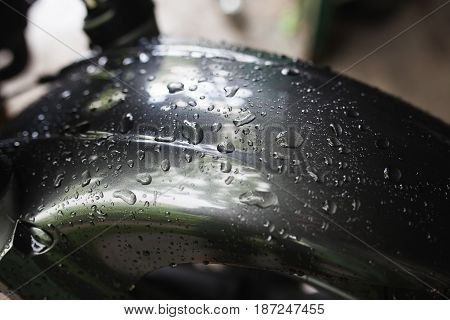 After car wash or rain, close up water drops on motorcycle hood