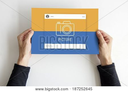 Hands holding placard with social media camera icon
