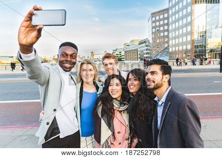 Group Of Business People Taking A Selfie In London