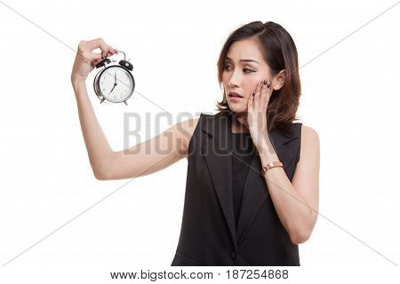 Young Asian Woman Is Stressed With A Clock.