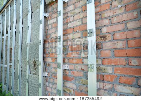 Exterior House Insulation Wall. Home Insulation & Reduced Heat Loss Outdoor for Energy Saving. Brick wall mineral wool insulation.