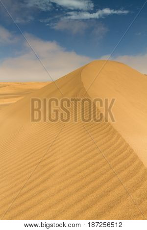 On top of a yellow sand dune near Swakopmund Namibia Africa