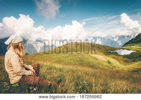 Woman Traveler relaxing enjoying mountains and lake landscape Travel Lifestyle concept adventure summer vacations outdoor