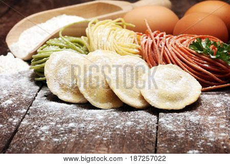 Fettuccine And Spaghetti With Ingredients For Cooking Pasta On A White Background, Top View. Flat La