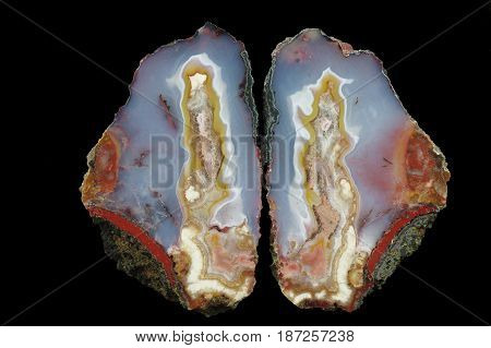 A cross section of the agate stone. A colorful center is in the blue chalice and pseudomorphs are on the shores. Multicolored silica bands colored with metal oxides are visible. Origin: Asni Atlas Mountains Morocco.