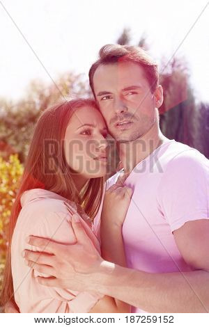 Affectionate young couple looking away in park