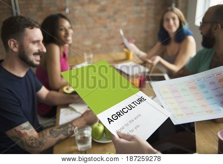 Group of workers working network graphic overlay on notepad