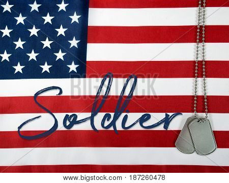 word soldier and military dog tags on American flag background