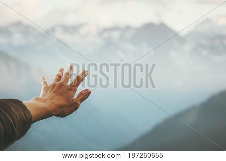 Hand touching Mountains landscape emotional Travel Lifestyle wanderlust concept adventure summer vacations outdoor calm harmony with nature