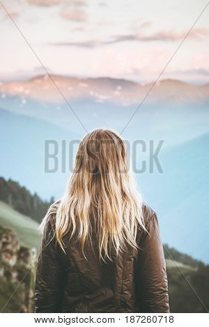 Young Woman enjoying sunset mountains landscape Travel Lifestyle wanderlust concept adventure summer vacations outdoor girl traveler blonde hair harmony with nature