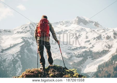 Climber Man hiking with backpack Travel Lifestyle concept adventure vacations outdoor snowy mountains landscape on background