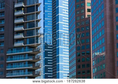 Architecture background of modern buildings standing close to each other. Urban development and urbanization concept