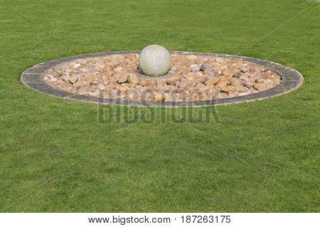 A Circular Rock and Stone Formal Garden Display.