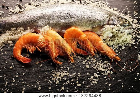 Delicious Fresh Fish On Dark Vintage Background. Fish With Aromatic Herbs, Spices And Vegetables - H